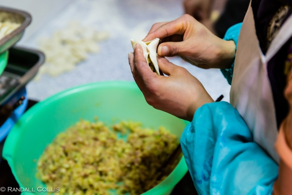 2.  Artfully distribute the fill as you begin the process of pinching together the sides of the dumpling…